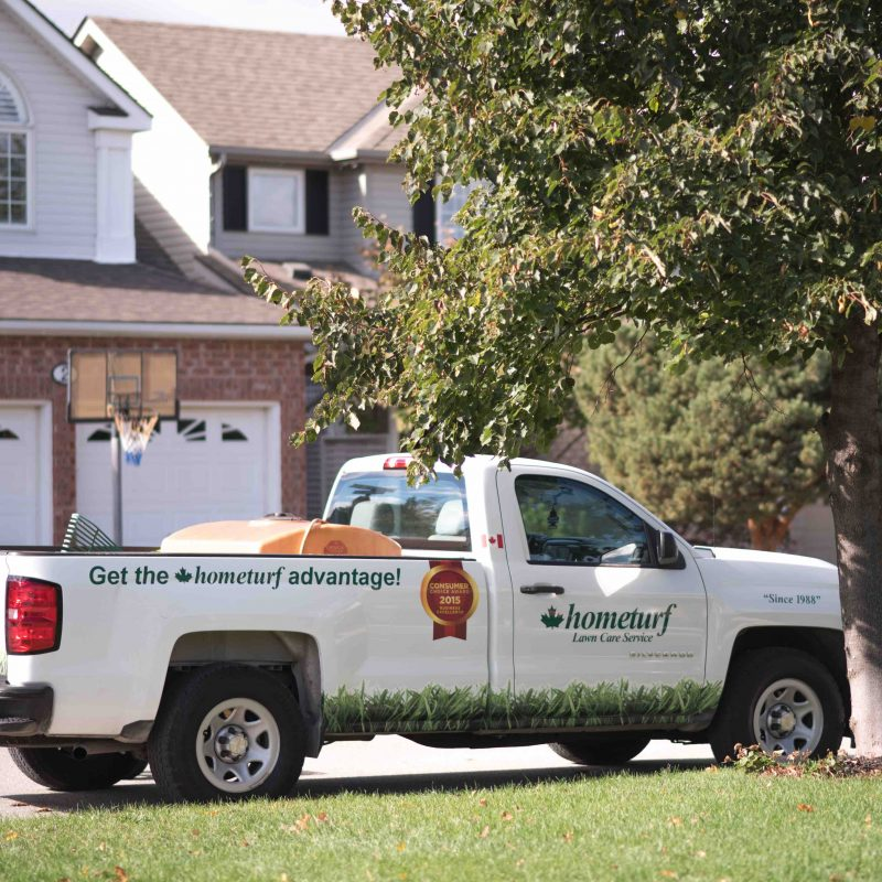 Hometurf lawn care truck parked outside a customer's property.