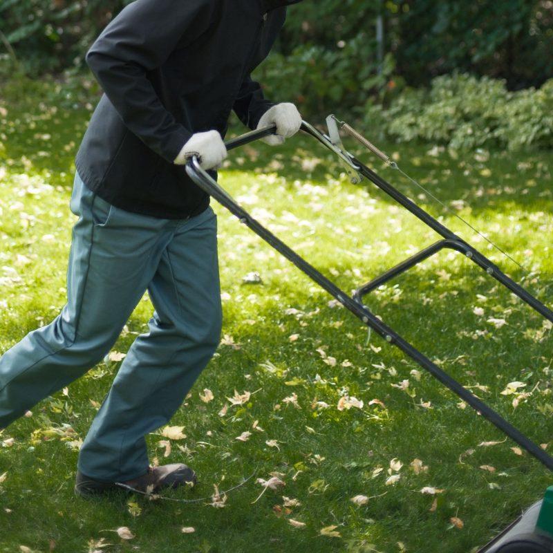 Hometurf lawn technician using a aerator machine on a customer's lawn.