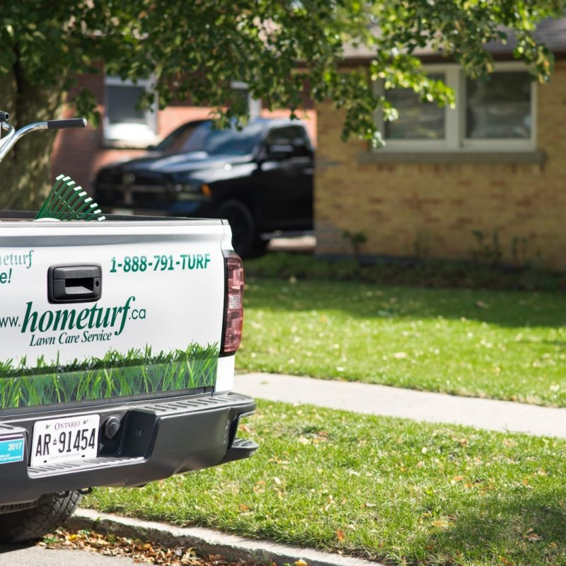 Photo of Hometurf technician's truck parked outside customer's property.